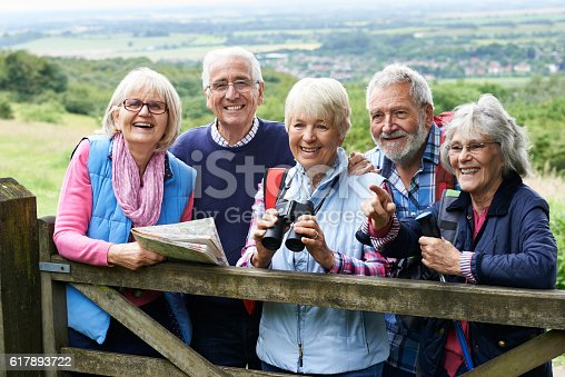 istock Group Of Senior Friends Hiking In Countryside 617893722
