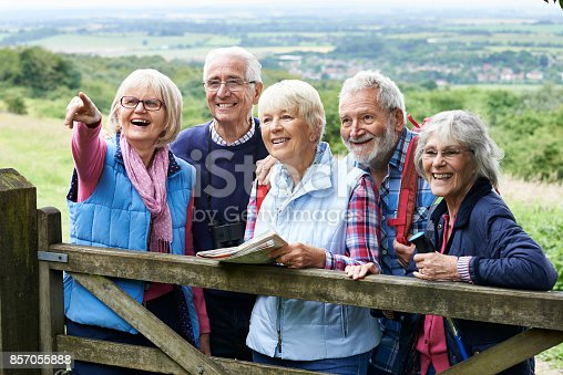 istock Group Of Senior Friends Hiking In Countryside 857055888