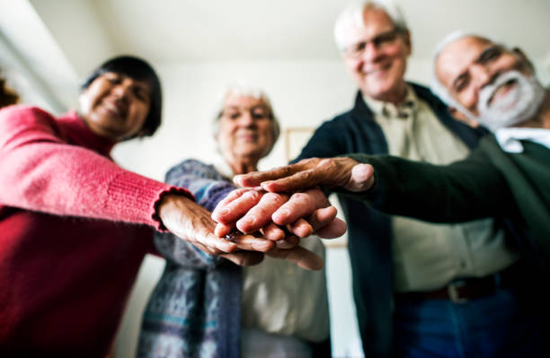 group of senior friends support concept - senior housing stock photos and pictures