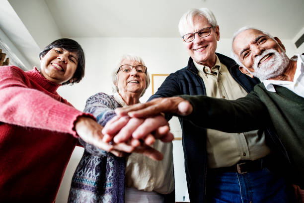 Group of senior friends support concept stock photo