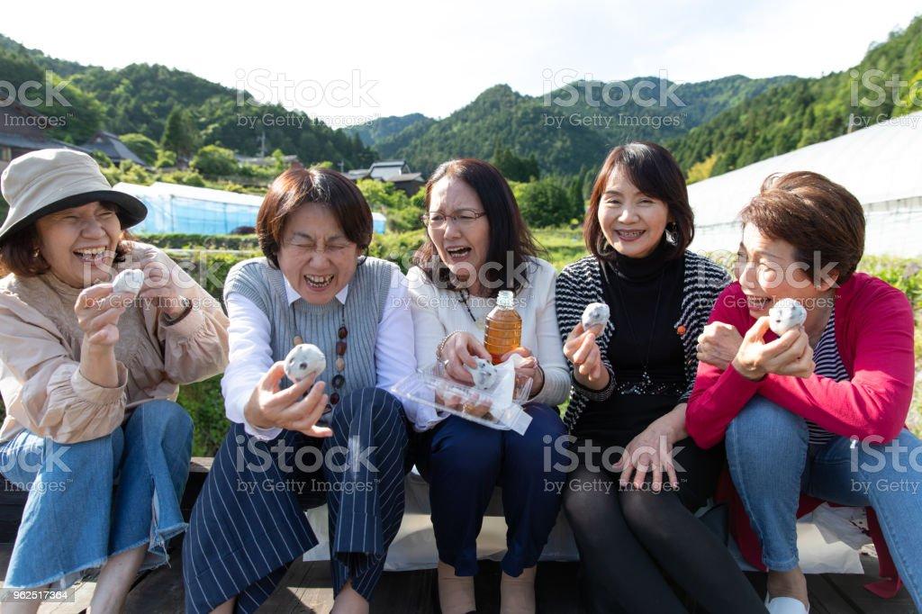 Group of senior Japanese female eating sweets - Royalty-free 60-69 Years Stock Photo