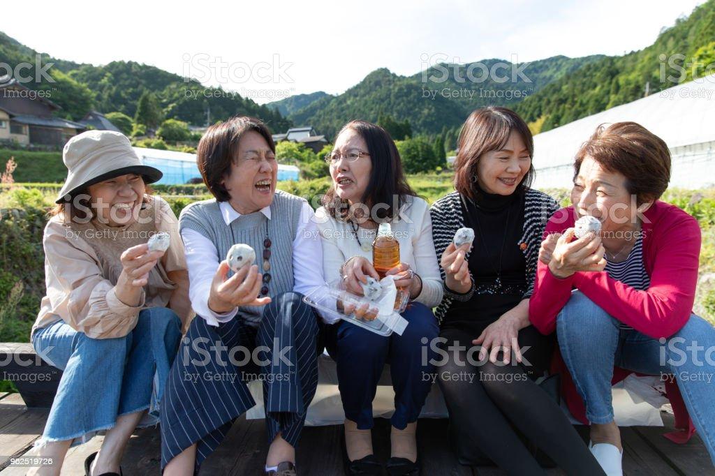 Group of senior Japanese female eating sweets stock photo