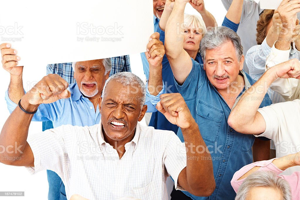 Group of senior men and women protesting royalty-free stock photo