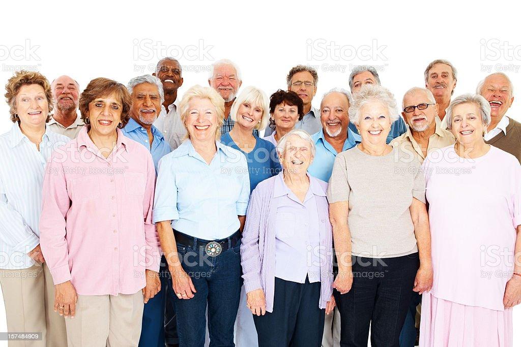 Group of senior people against white background stock photo