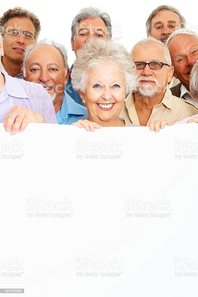 Group of senior people behind an empty billboard royalty-free stock photo