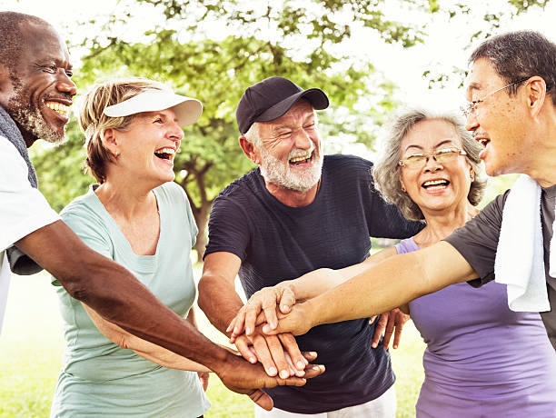 group of senior retirement exercising togetherness concept - スポーツ医学 ストックフォトと画像