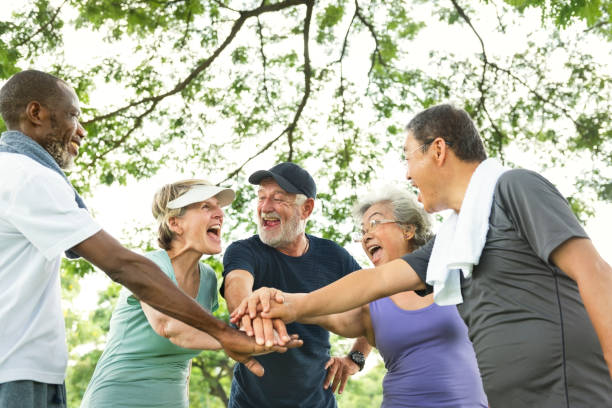 group of senior retirement exercising togetherness concept - elderly group stock photos and pictures