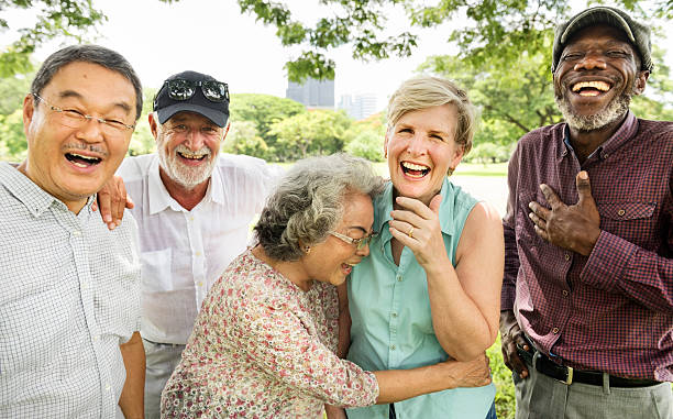 group of senior retirement friends happiness concept - rire photos et images de collection