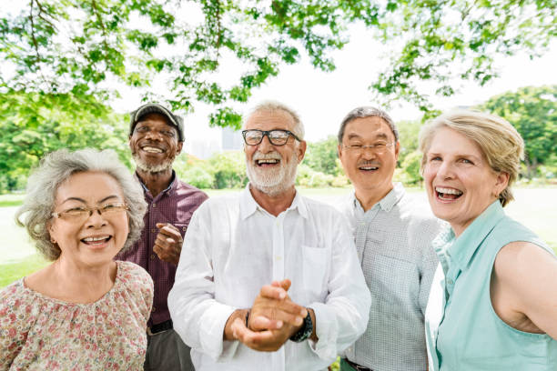 group of senior retirement friends happiness concept - idosos imagens e fotografias de stock