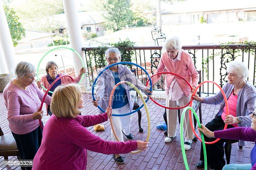 1047537292 istock photo Group of senior woman at a fitness class outdoors 985893328