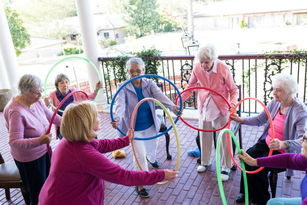 Group of senior woman at a fitness class outdoors stock photo