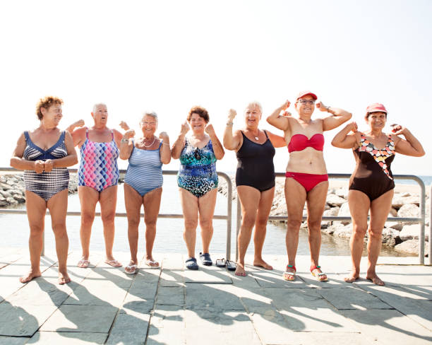 Group of senior women flexing their muscles stock photo