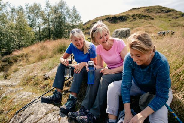 Group Of Senior Women Sharing A Few Jokes During Refreshment Break