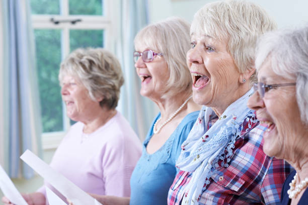 Group Of Senior Women Singing In Choir Together stock photo