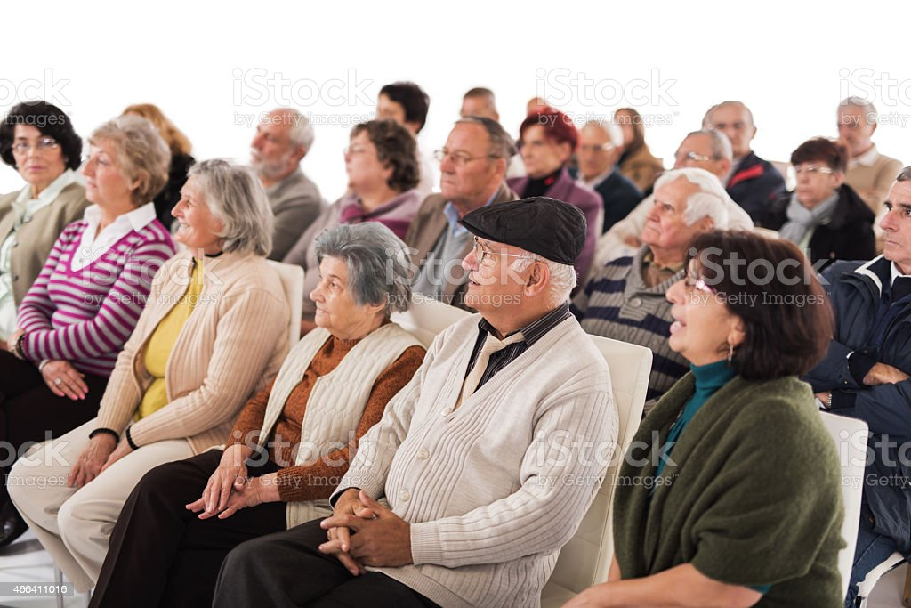 Group of seniors attending a seminar. Isolated on white. stock photo