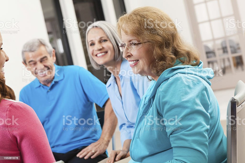 Group of seniors discussing something during support meeting stock photo