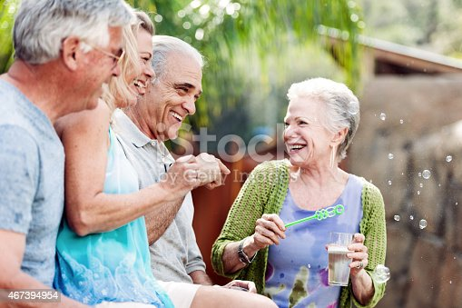 istock Group of seniors doing bublbles in the hot tub 467394954