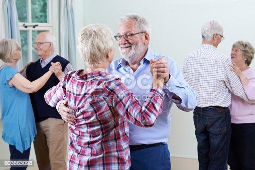 istock Group Of Seniors Enjoying Dancing Club Together 603863098