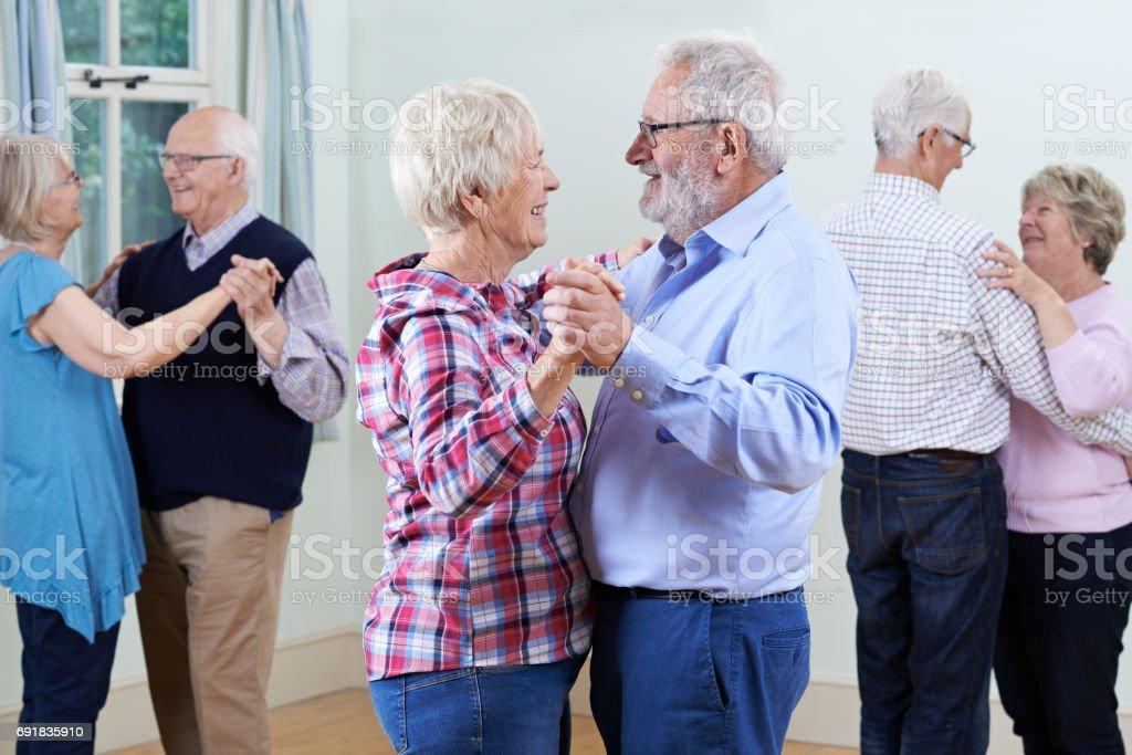 Group Of Seniors Enjoying Dancing Club Together stock photo