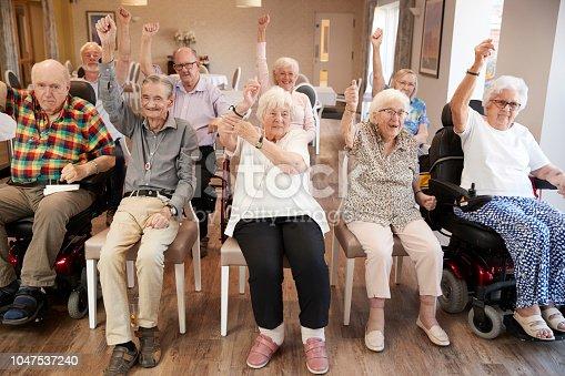 1047537292 istock photo Group Of Seniors Enjoying Fitness Class In Retirement Home 1047537240