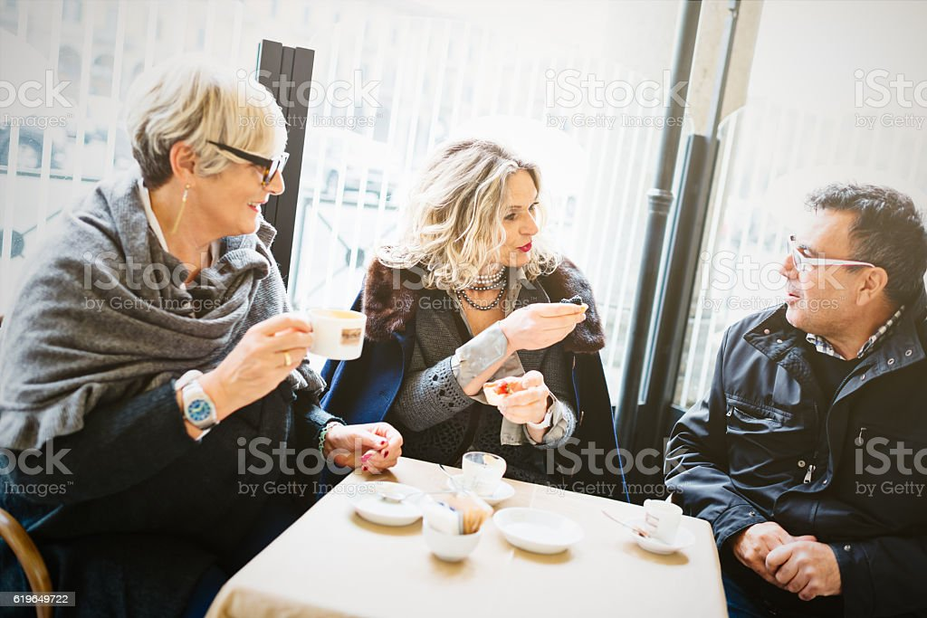 Group of seniors friends taking coffee stock photo