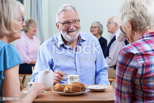 istock Group Of Seniors Meeting At Social Club 603860720