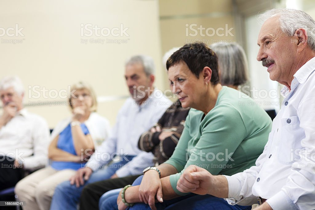 Group of Seniors Sitting and Paying Attention on the Seminar royalty-free stock photo