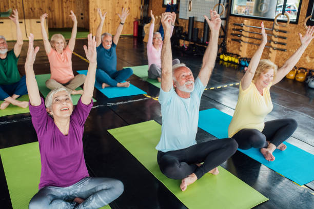 Group of seniors staying active with yoga stock photo