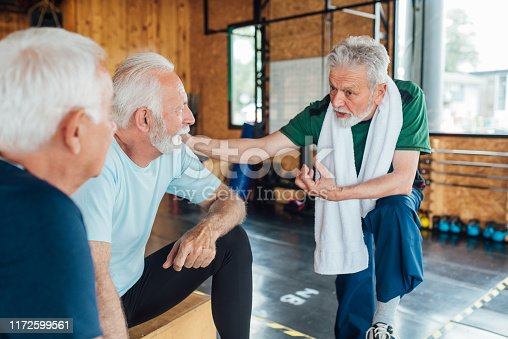 1047537292istockphoto Group of seniors talking after their yoga training 1172599561