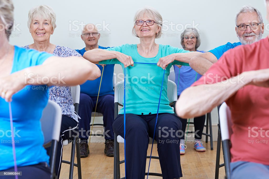Group Of Seniors Using Resistance Bands In Fitness Class stock photo
