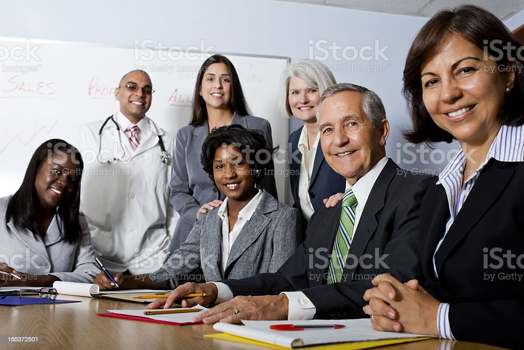 Group of seven multi-ethnic and mixed aged professionals royalty-free stock photo