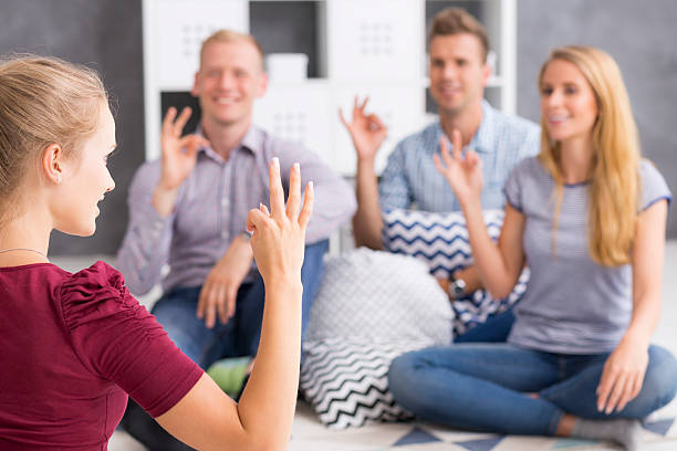 group of sign language learners - sign language stock photos and pictures