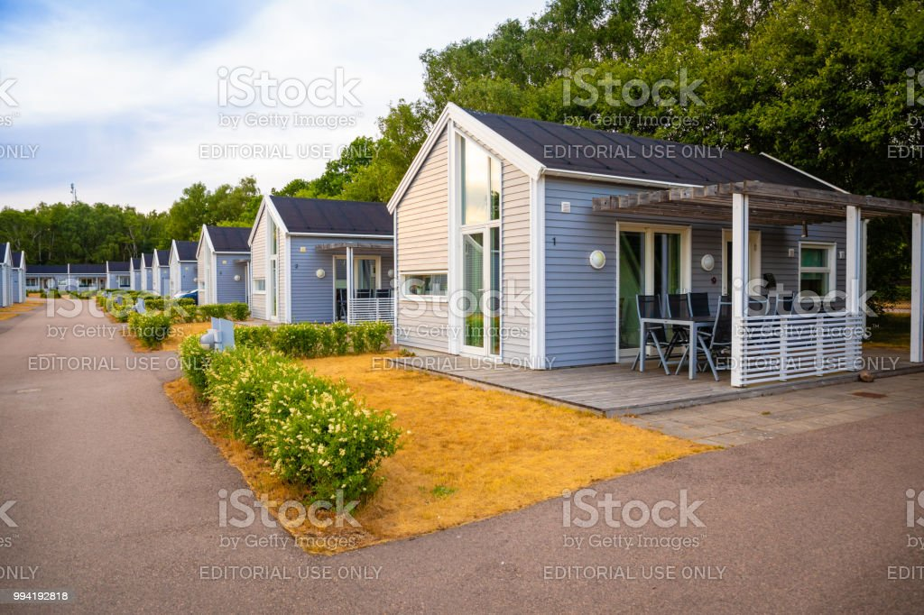 Group Of Similar Grey Camping Cabins In Small Swedish Town Raa
