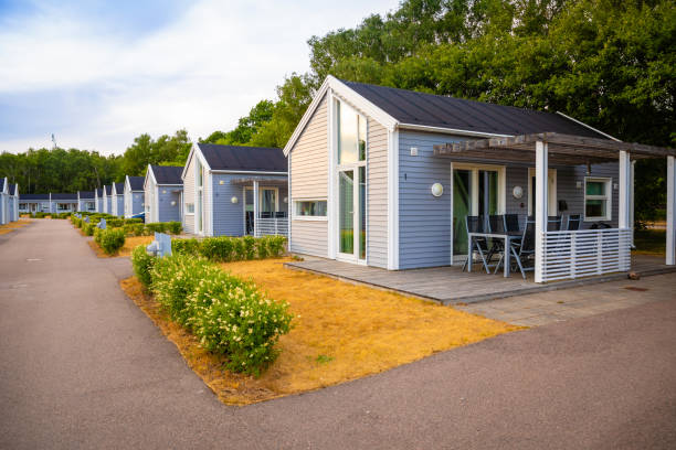Group of similar grey camping cabins in small swedish town Raa Raa, Sweden - June 17, 2018: Group of similar grey camping cabins in small swedish town Raa, Sveden bungalow stock pictures, royalty-free photos & images