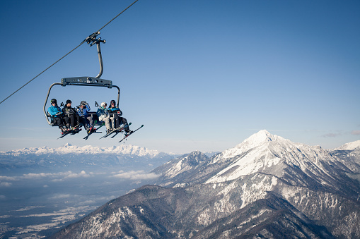 Group of skiers on a ropeway