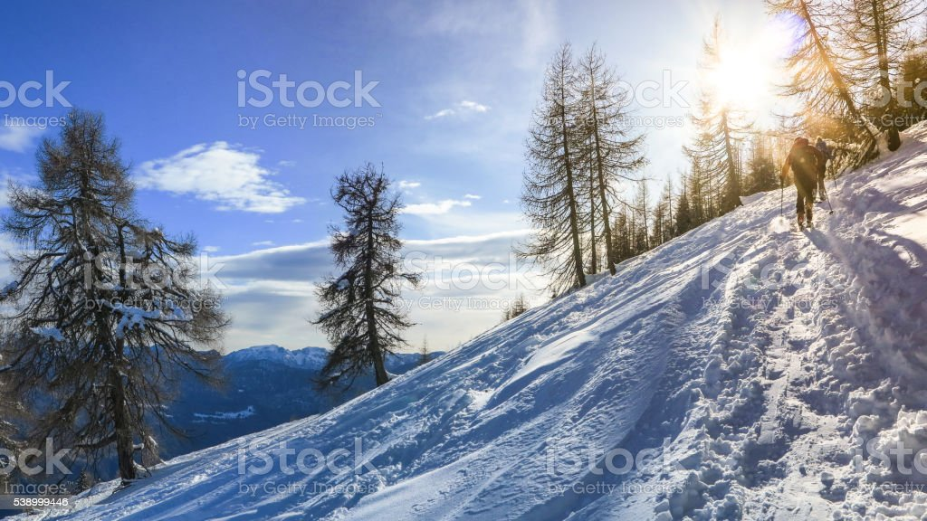 group of skiers start the descent  Valle Blanche, the most stock photo