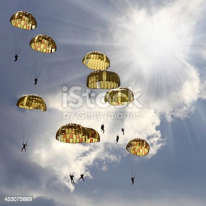 istock A group of skydivers with the parachutes open 453075669