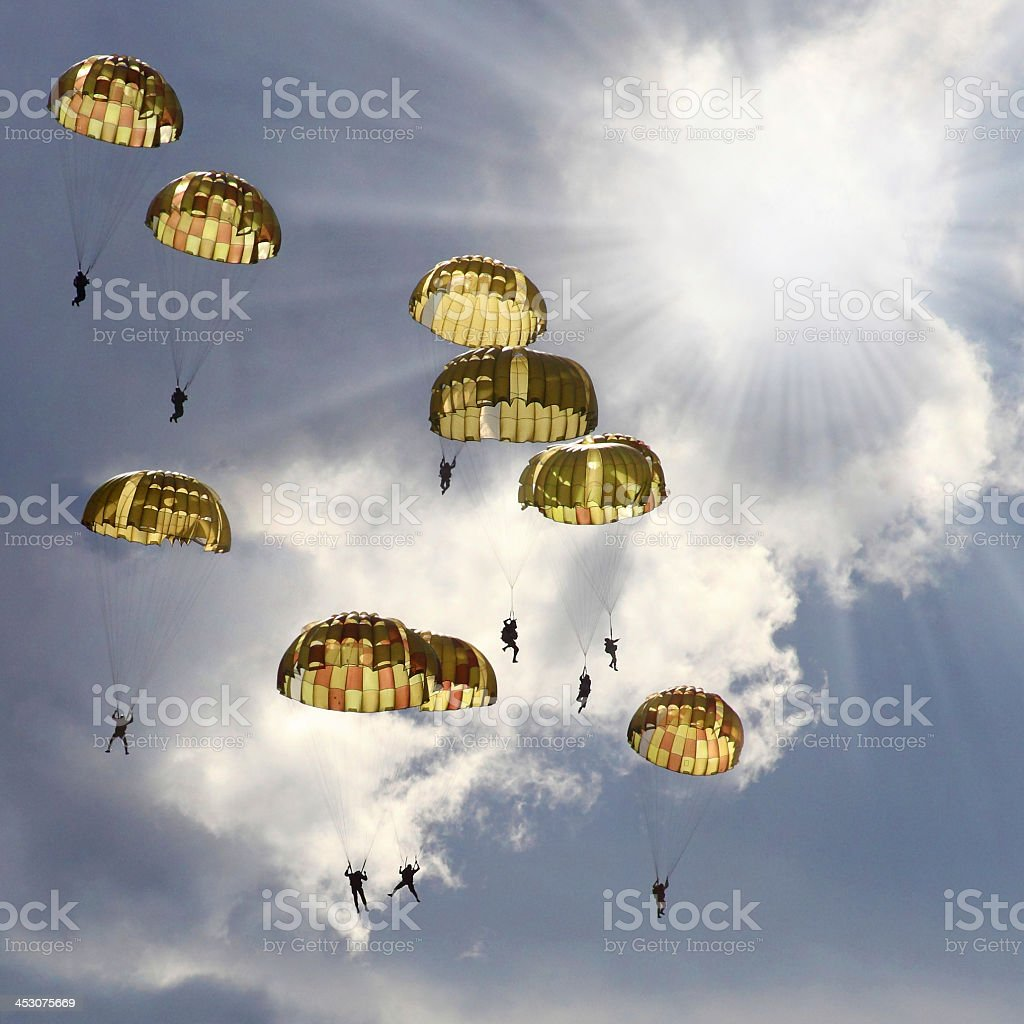A group of skydivers with the parachutes open stock photo