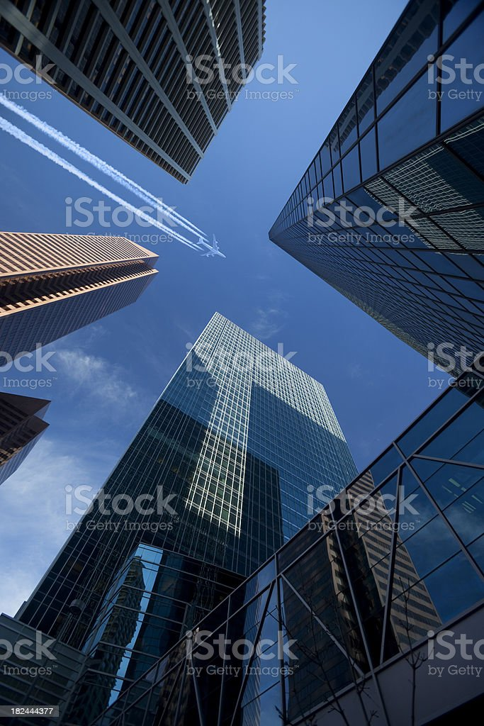 Group of Skyscrapers and Jet royalty-free stock photo