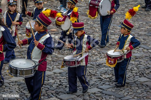 istock Group of small children Marching Band in Uniforms - Antigua, Guatemala 692328366