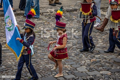 istock Group of small children Marching Band in Uniforms - Antigua, Guatemala 692337540