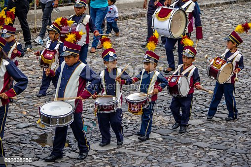 istock Group of small children Marching Band in Uniforms - Antigua, Guatemala 692368256