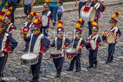 istock Group of small children Marching Band in Uniforms - Antigua, Guatemala 692371276