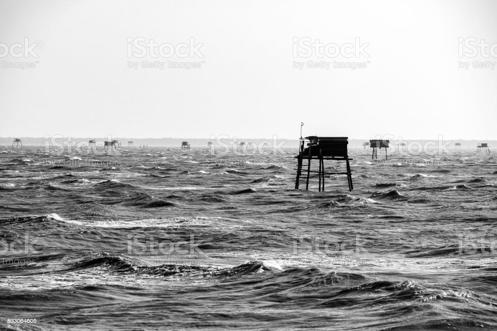Group of small houses in the sea. Black and white