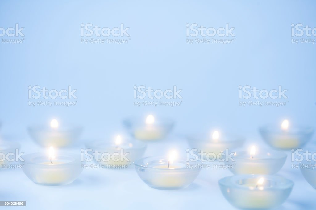 Group of small lit votive candles stock photo