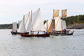 Stockholm, Sweden, June 13, 2015: Group of small, old sailing ships rowing rapidly from Grisslehamn (Sweden) to Eckero(A…land) in the public event Postrodden, June 13, 2015 in Grisslehamn, Sweden
