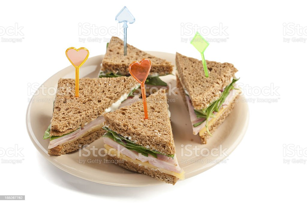 Group of small triangle tea sandwiches stock photo