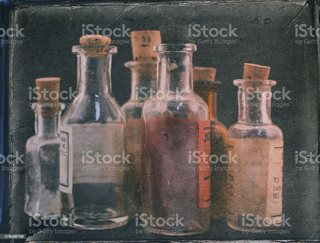 Group of small vintage translucent medicine bottles. stock photo
