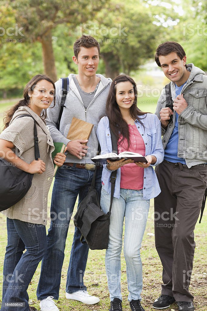 Group of smiling buddies studying royalty-free stock photo