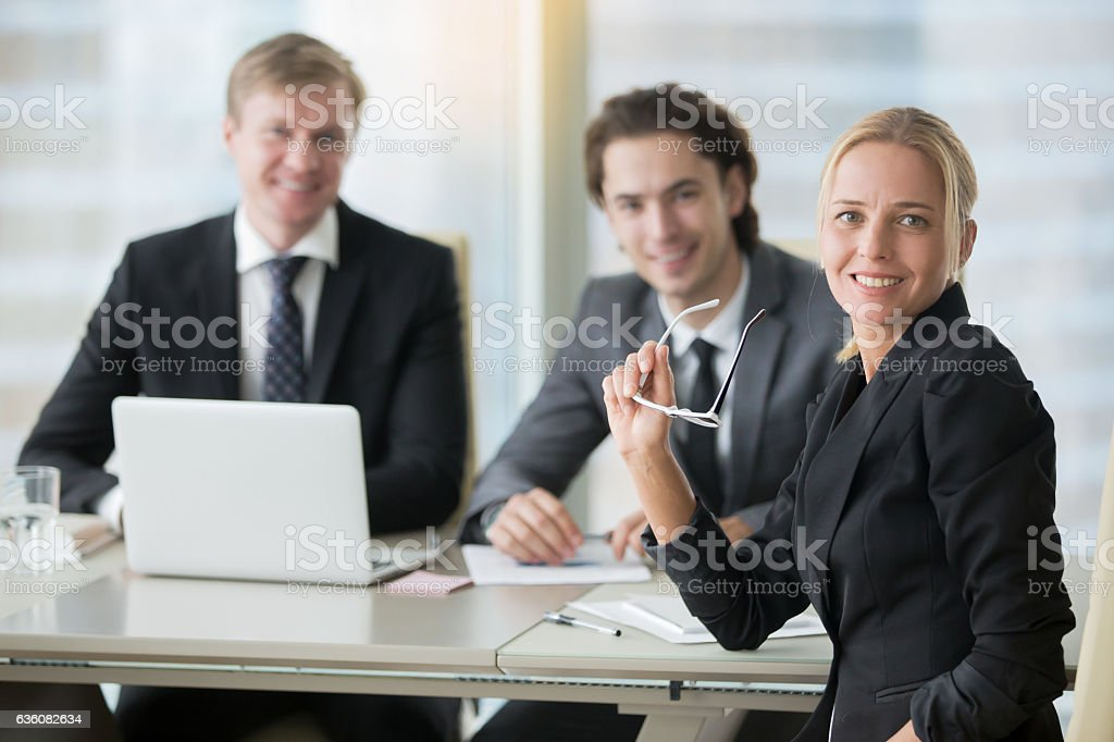 Group of smiling businessmen at the modern office desk stock photo